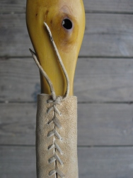 detail of osage bow and braintan handle