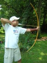 Delbert draws his new Cherokee style osage bow, 'Rainbow'